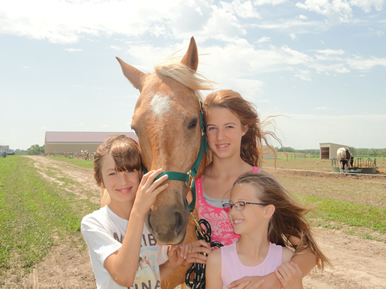 kids with horse at Dakota Stables