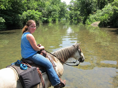 Crossing River on Horseback