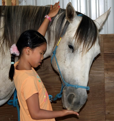 girl with horse at Dakota Stables